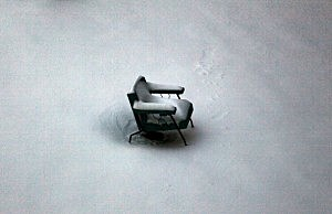 snow on patio chair