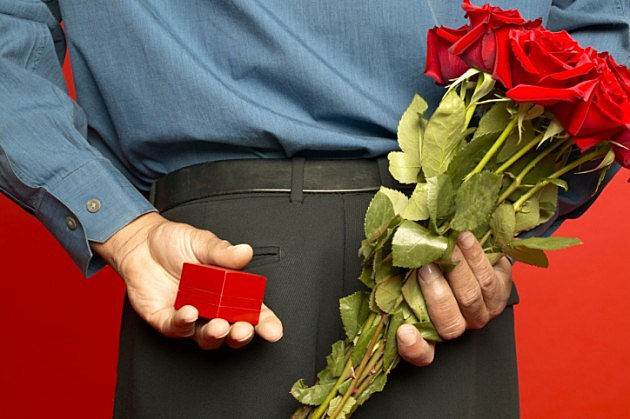 Holding-red-roses-and-engagement-ring-credit-Brand-X-Pictures-78401600-1-630x419